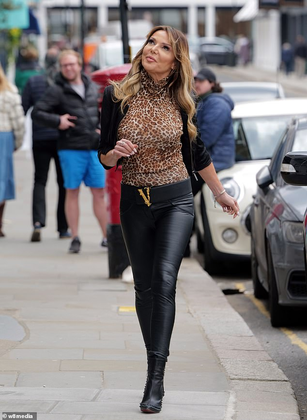 Style: Lizzie kept the chill out by adding a fringed leather jacket to her look, while her narrow waist was tightened by a black belt with a gold buckle