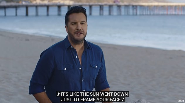 There he is: Bryan also stars in the new video as he sings from the beach