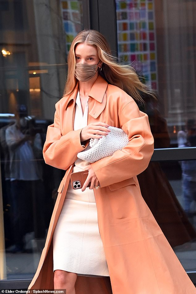 A vision: Pairing the spring issue with a crisp cream blouse and leather midi, the supermodel, 33, looked effortlessly stylish as she left her New York hotel