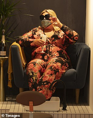 C'est la vie: Gemma, wearing a face mask, held up a glass of champagne as she prepared for her day of care on Wednesday