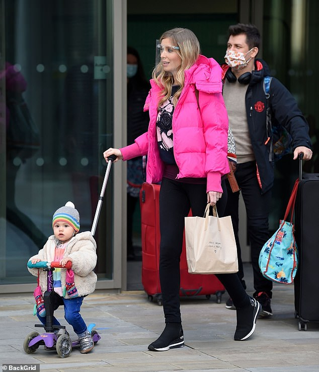 Rachel Riley steps out for the first time since announcing she is pregnant with her second child as she enjoys a stroll with husband Pasha Kovalev and their daughter Maven