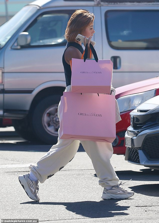 Shopping spree: She styled her bright orange hair in a short bob and carried several shopping bags, including two pink bags from Double Bay boutique Girls with Gems