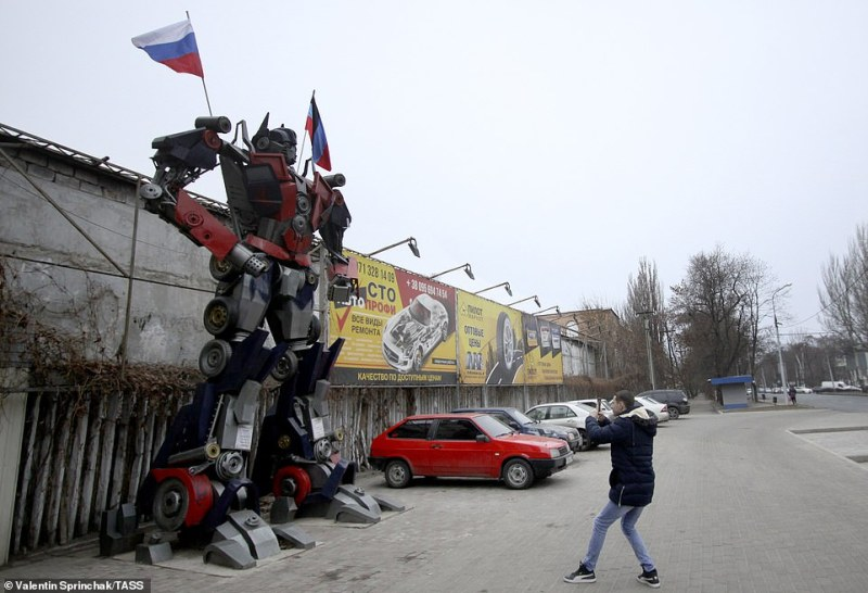 One of the transformer robots has a Russian flag on his shoulder as he stands on a street in Donetsk, in the pro-Russian region of eastern Ukraine