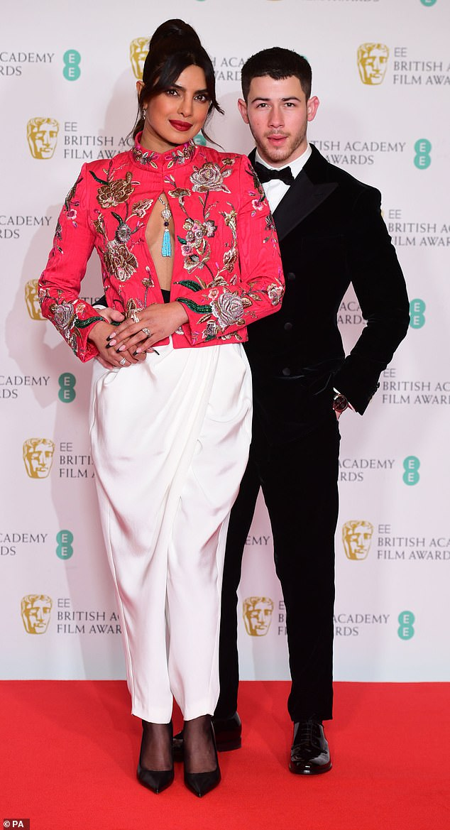 Couple: The musician, 28, is in England where his actress wife Priyanka Chopra, 38, is filming her new TV mini series Citadel. They attended the BAFTA Film Awards in London on Sunday