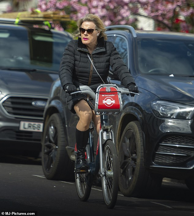 In her element: Wrapping up against the blustery weather, the actress kept warm in a quilted black jacket