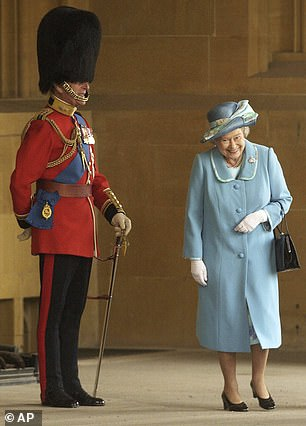 Philip was Colonel of the Grenadier Guards from 1975. He is pictured in uniform with the Queen in 2003