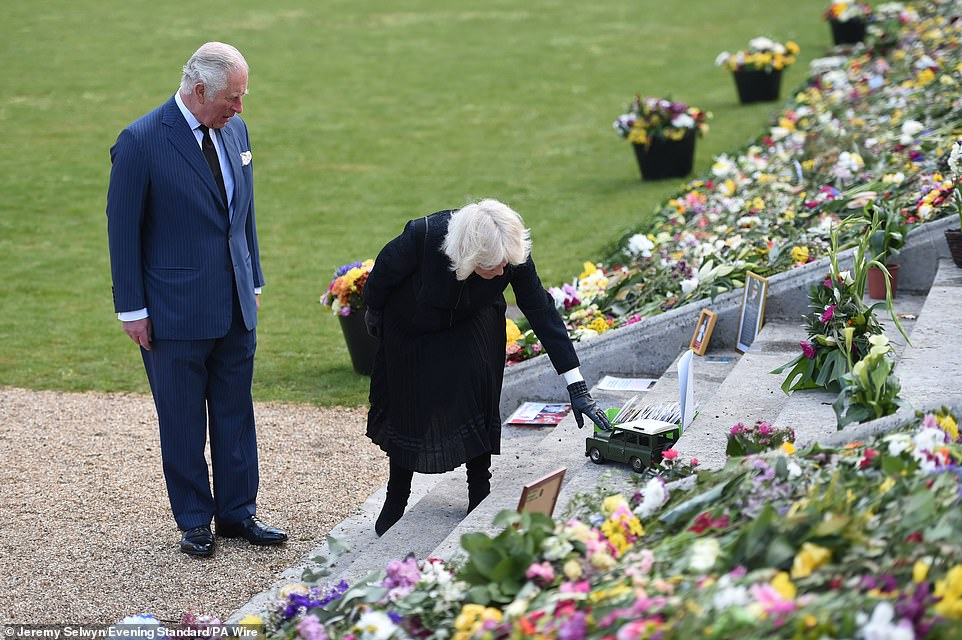 Camilla paused to touch a toy Land Rover, Philip's favourite car, which will also be used as his hearse this Saturday
