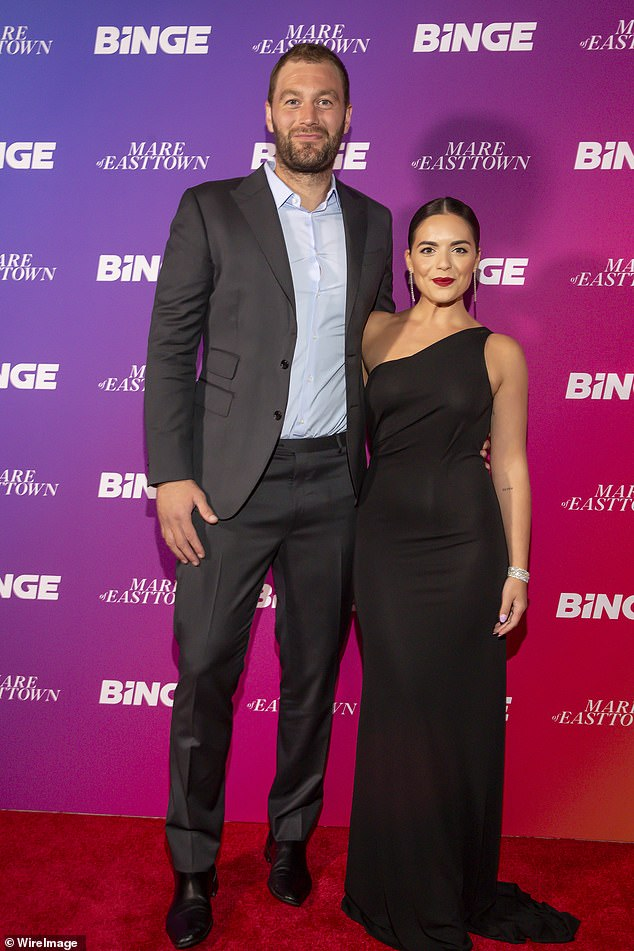 Shining bright! Olympia Valance showed off her stunning diamond ring as she attended the Mare of Easttown premiere with her fiancé Thomas Bellchambers in Melbourne on Thursday