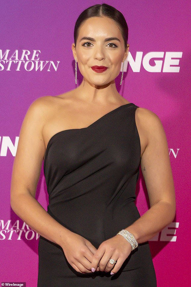 Glamorous:Olympia looked glamorous in a long black one shoulder frock. She teamed the stylish dress with silver statement earrings and a bracelet