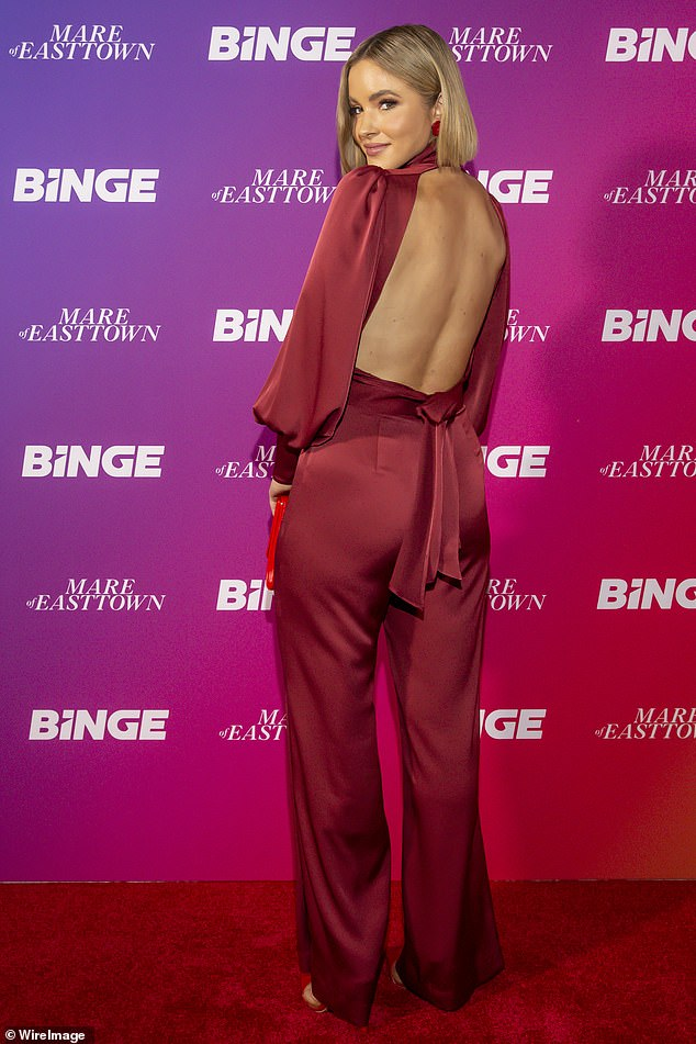 Red hot!The 29-year-old model dressed to impress in a red satin jumpsuit which featured a high neck, puffy sleeves and was cinched in at waist
