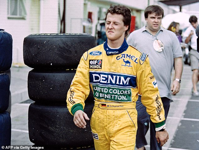 An angry Schumacher storms down the pits after retiring from the race in South Africa
