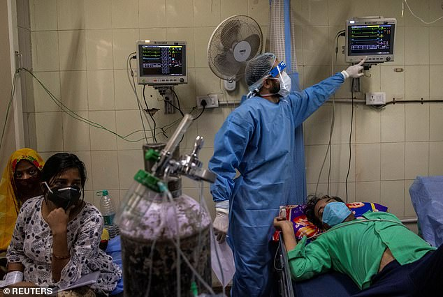 While China has managed to reduce its own Covid cases near-zero and reopen its economy, the rest of the world is still seeing surging cases (pictured, a hospital in India)