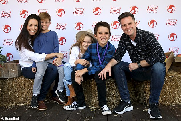 Family:The pair enjoyed a family day out with their children, son Leo, 10, and twins Billy and Betty, five