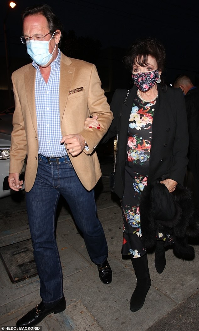 Arm in arm:The 87-year-old Dynasty star and her fifth husband Percy Gibson, 56, were spotted heading to the celebrity hot spot Craig's in West Hollywood