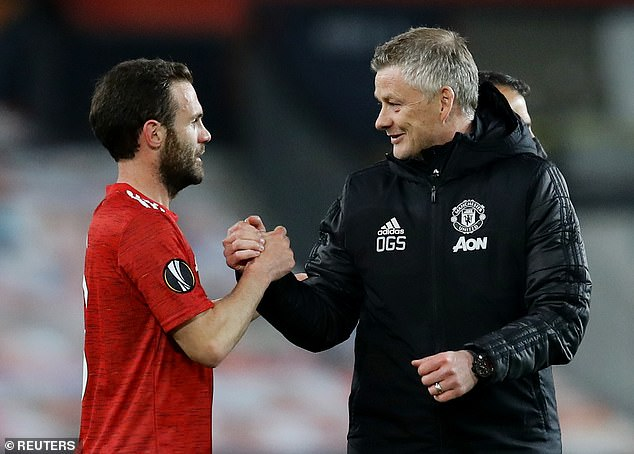 Ole Gunnar Solskjaer shakes the hand of Juan Mata after Manchester United secured their passage to the semi-finals of the UEFA Europa League