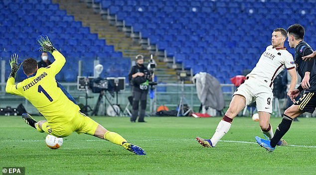 They watched from the stands as striker Edin Dzeko (second right) scored against Ajax