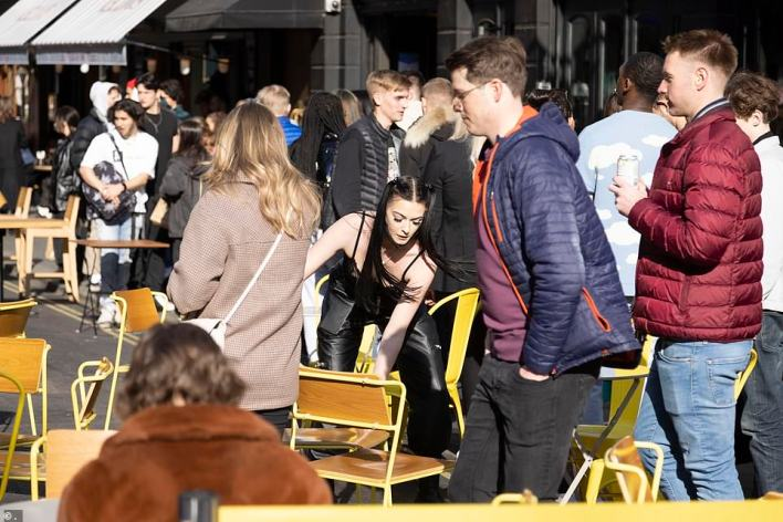 The Soho revellers were spotted with pints of beer in hand as they gathered outside pubs and bars to enjoy the autumn sun