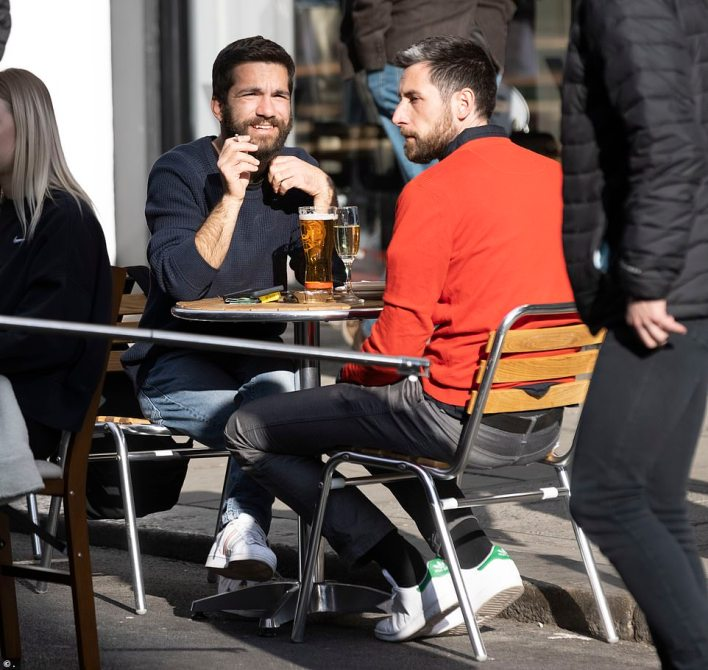 This man enjoyed a pint of beer whilst his companion opted for a glass of champagne on what was their first Friday at a bar since January