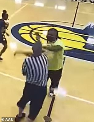 The referee slaps the phone out of the man's hands