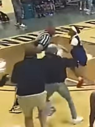 The ref is flipped over by the spectator