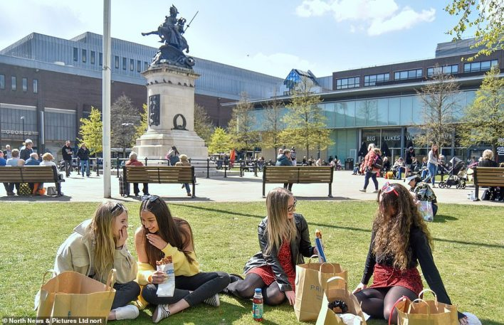 A group of women make the most of the sunshine by relaxing outdoors at Old Eldon Square in Newcastle city centre today