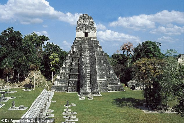 Before the Teotihuacan conquered Tikal in 378, they may have been allies.  Pictured: Temple of the Great Jaguar in Tikal