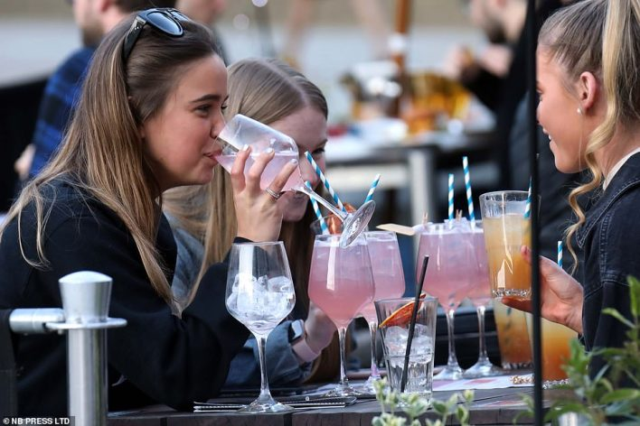 A group of young revellers enjoy drinks in Leeds on the first Friday night out since lockdown restrictions were eased