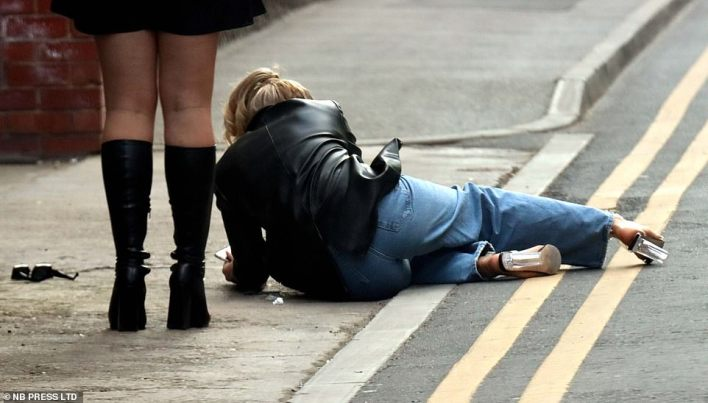 One reveller loses her footing in Leeds city centre on the first Friday night out for drinkers since restrictions were eased