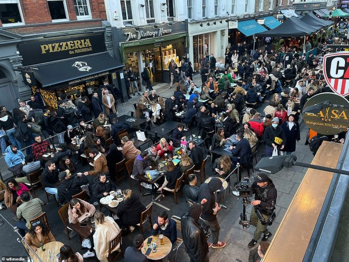 People flock to Soho to enjoy the first Friday night drinking since covid restrictions were lifted