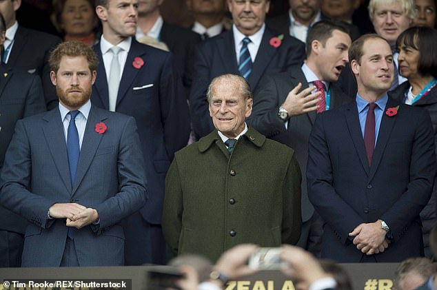 Prince Harry, Prince Philip and Prince William at Twickenham Stadium in October 2015