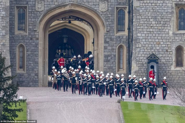 Insiders stressed that the arrangement should not be taken as a sign that the brothers refused to walk alongside each other. Pictured: Troops leave Windsor Castle after a rehearsal for the Duke of Edinburgh's funeral