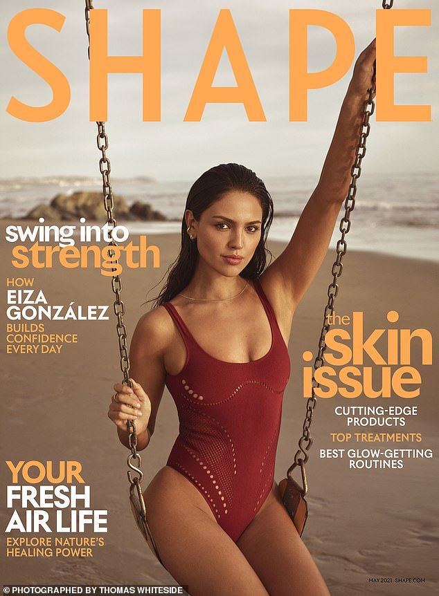 Covergirl: The principal lady wore a red one-piece swimsuit for the cover of the May issue of Shape magazine