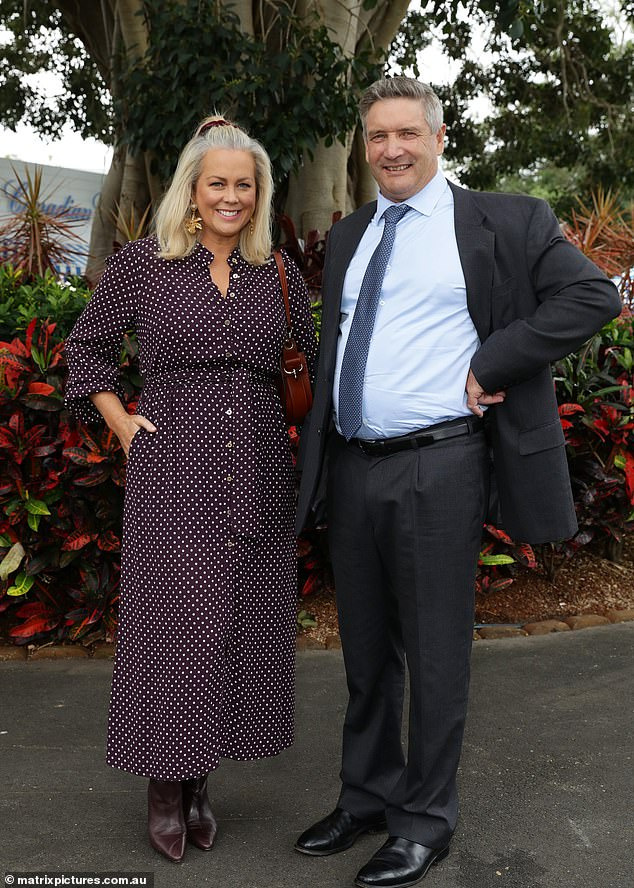 Loved up: The equine businessman looked dapper in a suit as he happily posed for photos with his beautiful wife