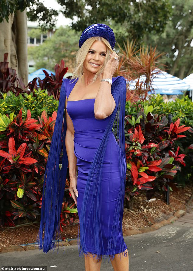 All eyes on her! The blonde bombshell wore a stunning cobalt frock by designer Alex Perry that hugged her trim and toned physique