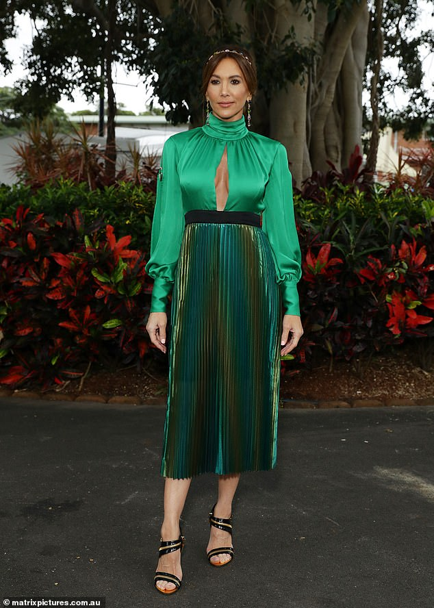 Making them green with envy! Kyly Clarke dressed to impress in a bold green dress at the race day event