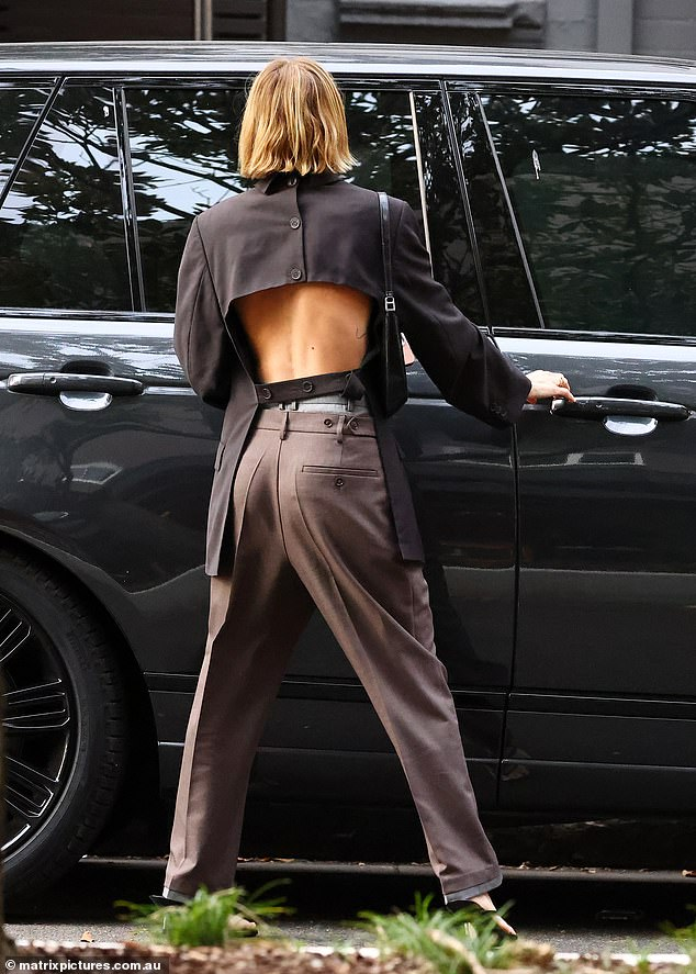 To flash!  The posh model flashed her back as she got into her car
