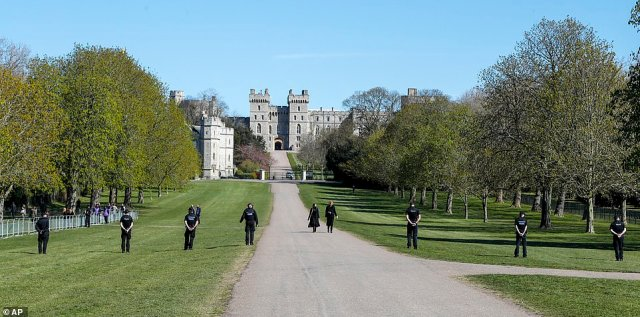 Police inspect the Long Walk early this morning ahead of the Duke of Edinburgh's funeral