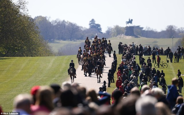 The King's Troop Royal Horse Artillery move along The Long Walk towardsthe castle ahead of the procession this afternoon as crowds amassed