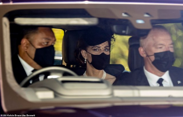 The Duchess finished off her look with elegant make-up and wore her brunette locks beneath a black hat and veil