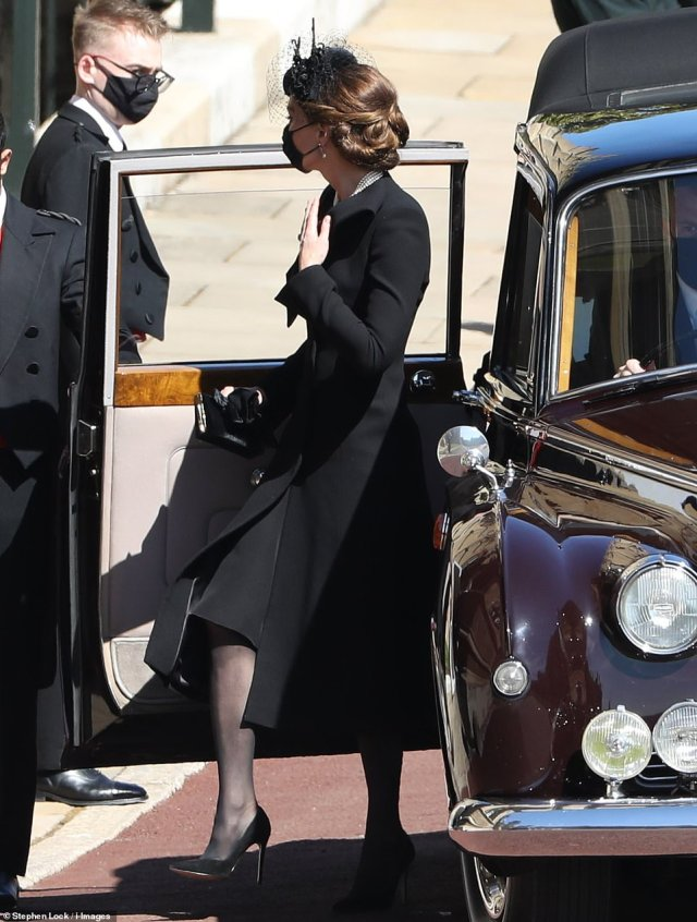 The Duchess of Cambridge steps out of a car at Windsor Castle at the Duke of Edinburgh's funeral this afternoon