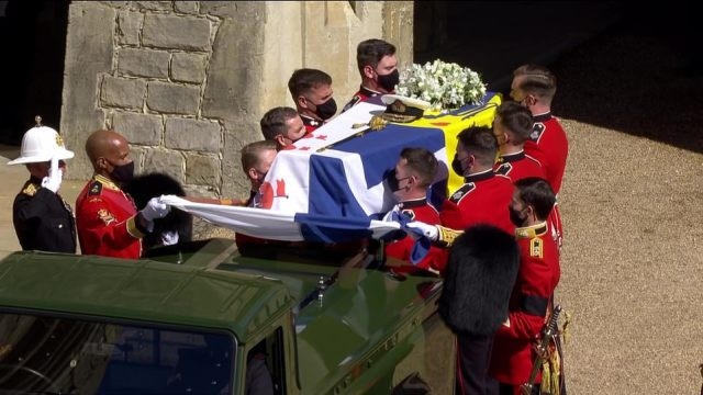 The coffin was lowered gently on to the Land Rover hearse