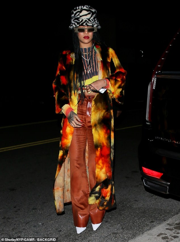 Wow!  Rihanna showed off her quirky sense of style in a tie-dye fur coat as she stepped out for a late-night dinner with her family at Giorgio Baldi's in Santa Monica on Friday