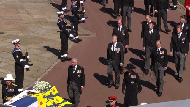 Prince Charles looked emotional next to his siblings with his children following behind