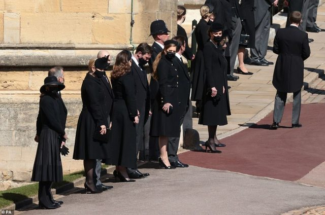 The Duchess of Cambridge (far right) waits with members of the royal family Zara Tindall, Mike Tindall, Princess Eugenie, Jack Brooksbank, Princess Beatrice and Edoardo Mapelli Mozzi outside St George's Chapel,