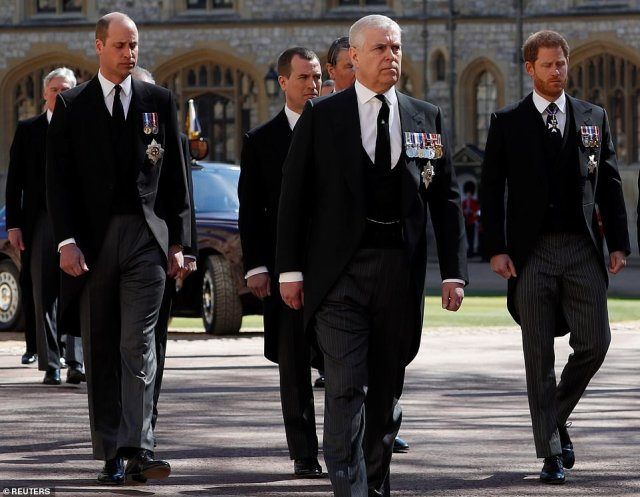 Prince Andrew walks in the procession following Philip's coffin into St George's Chapel at Windsor Castle this afternoon