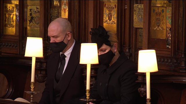 Mike and Zara Tindall also looked in tears as the couple bowed their heads during the funeral