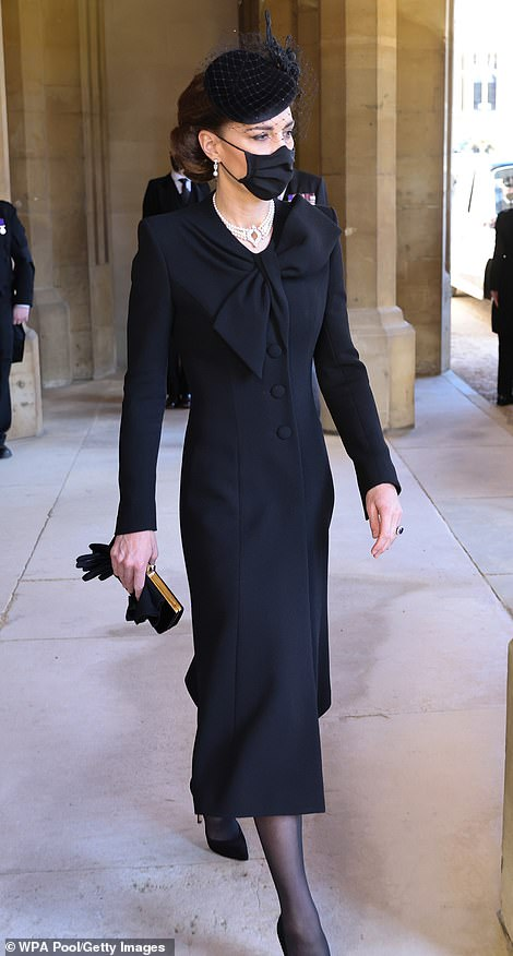 Once outside the chapel, the Duchess wore a long buttoned coat over her Roland Mouret dress