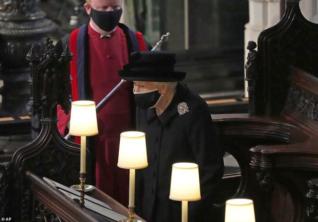 Britain's Queen Elizabeth II takes her seat alone in the quire of St. George's Chapel