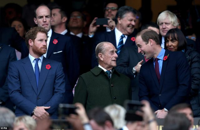 Prince William laughs with his grandfather Prince Philip (centre) at the Rugby World Cup Final at Twickenham in October 2015