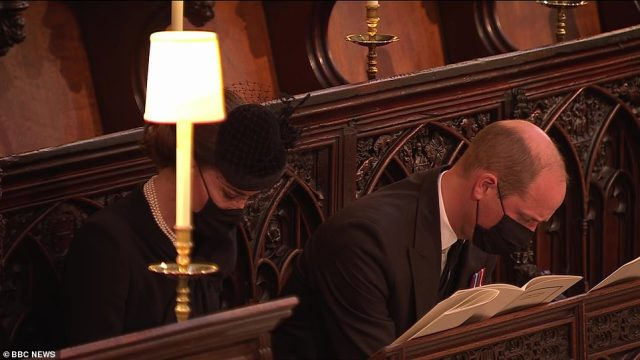 The Duke and Duchess of Cambridge sit opposite Prince Harry at St George's Chapel in Windsor Castle this afternoon